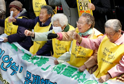 South Korean women, who say they were forced to serve Japanese soldiers as sex slaves during World War Two, shout slogans during an anti-Japan protest in front of the Japanese embassy in Seoul March 30, 2011. The protesters demanded an official apology over the issue that Japan systematized