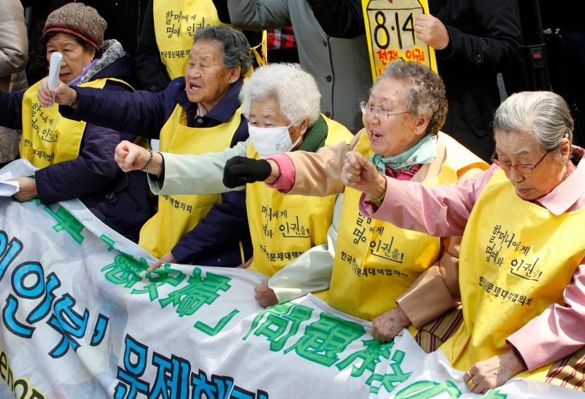 South Korean women, who say they were forced to serve Japanese soldiers as  sex slaves during World War Two, shout slogans during an anti-Japan protest  in ...